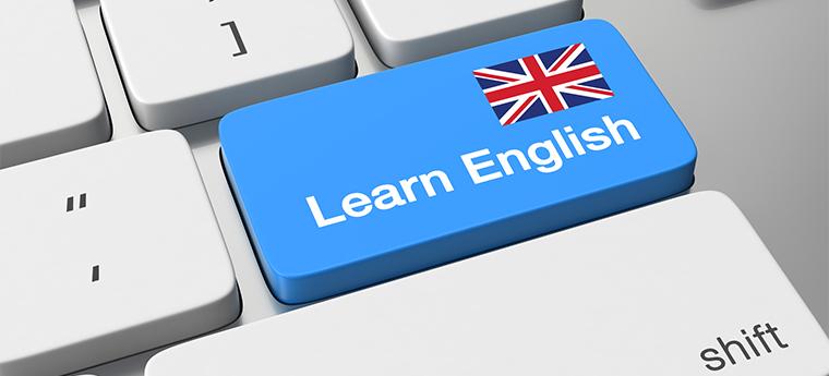 Tecla enter do teclado é substituída por uma azul com a inscrição Learn English e a bandeira da Grã-Bretanha