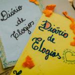 dois exemplos de como a professora fez o caderno de elogios com a turma, com o nome caderno de elogios na capa